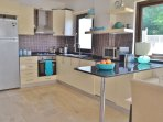 Large, well-equipped fitted kitchen with granite worktops and breakfast bar