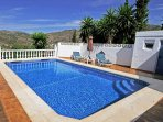 Nice Pool area with sun loungers and mountain view and separate toilet in the pool area
