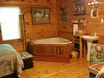 The Loft At Big Rock Log Cabin Is Furnished With Jacuzzi, Sink And Toilet Closet.