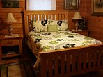 Master Bedroom At Big Rock Log Cabin Features Pillow Top Queen Bed.