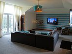Very large living room with Sky TV