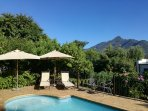 Outdoor swimming pool with mountain backdrop