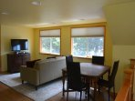 Dining room table with seating for up to 6 people, plus two in the kitchen.