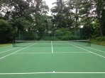 Tennis court with basketball backboard