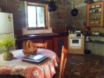 Kitchen in River Cottage - full size fridge, compact 2 burner stove with oven and small grill