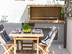 The dining table is ideal to enjoy your meal under the pergola
