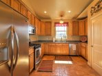 With stainless steel appliances, ample counter space and a 4-person curved island, you'll love playing head chef in...