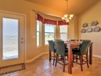Share your meals at the adjacent 6-person table, topped with granite and tucked away in a nook with bright bay windows...
