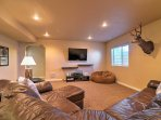 A second gathering space in the basement ensures everyone has their own space to play!
