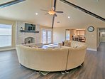 Take a seat on the large plush couch and put your favorite show on the flat-screen cable TV in the living room.