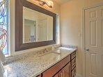 The en suite master bathroom offers a walk in shower and separate tub.