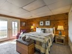 Large lower king bedroom suite off gameroom.  Private deck to mountain view and hot tub.