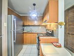 Cook delicious homemade meals in the fully equipped kitchen featuring modern appliances.