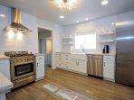 Lovely Farm Sink, Dishwasher, top of the line refrigerator/freezer. Quartz Countertops