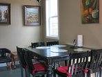 THERE IS A BIG DINING TABLE FOR 6 GUESTS IN THE KITCHEN