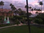 Lanai view of sunset and fountains.