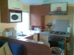 The kitchen has a full-sized oven & hob, microwave, kettle toaster. (Also large fridge- freezer.)