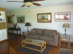 Remodeled living room with wood floors, original art and no clutter. Room for your stuff!