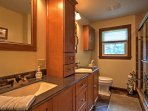 The full bathroom boasts a his and her sink, new fixtures, and a walk-in shower.