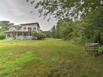 This home is nestled on 1 lush acre of land.