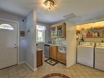 An additional kitchenette and in-unit laundry machines are available.