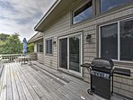 Host a backyard barbecue on the deck using the gas grill.