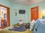 The master bedroom features a plush queen-sized bed and flat-screen cable TV.