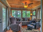 Long-view windows let in plenty of natural light, along with lush views of the surrounding area.