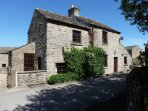 This cosy cottage is on the edge of the village green. Ample parking for 3 cars