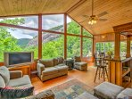 The floor-to-ceiling windows in the great room offer mesmerizing views of the mountains and dense forest.