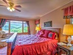 There's a large window with a great view of the mountains in the master suite.