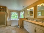 The soaker tub in the en suite master bathroom is the ideal place to relax after a long day in the mountains.