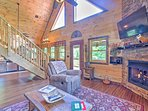 This beautiful cabin offers rustic wood paneling and vaulted ceilings.