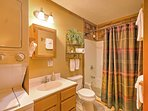 The en suite bathroom offers a shower/tub combo.