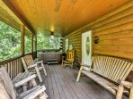 The rustic cabin features a spacious deck with private hot tub and plenty of outdoor furniture.
