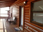Cabin length covered front porch provides a view of Mt. LeConte