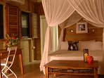 Inside the dreamy honeymoon suite, with a king size bed, private en suite and A/C