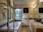 Attached master bathroom with jetted tub