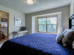 Upper level master bedroom with new King bed and attached bathroom.