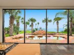 The commercial floor to ceiling glass windows really show off the views of the pools, gardens& ocean