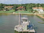 Aerial view of the boathouse, boat lifts, fishing area, pier, gardens and house