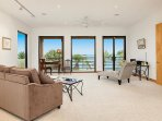 Sit in comfort and tranquility watching the bay from the master living room.