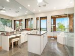 Enjoy the wide open master bathroom with twin sinks and a makeup area.