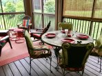 Large, screened porch has 4 comfy adirondack chairs plus a dining table with a lovely mountain view