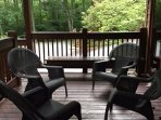 Plenty of seating on covered deck for rainy day enjoyment
