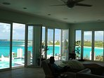 Relax in the Great Room encased by glass doors overlooking the pool and Caribbean Sea!