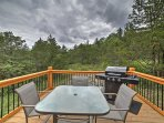 Cook up some burgers on the gas grill as you enjoy the view from the deck.