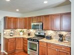 The fully equipped kitchen is complete with wood elements, granite counter tops, and ample counter space!