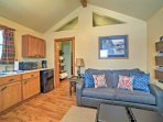 Vaulted ceilings and hardwood floors fill the living space.