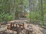 This secluded cabin offers the peace and quiet of the woods.